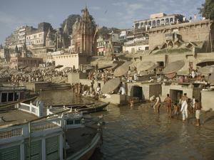 Hindu Pilgrims Wash Away Sins in the Ganges by John Scofield