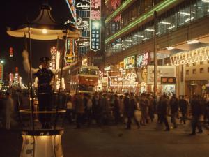 Pedestrians Swarm Through Kowloon's Shopping District by John Scofield