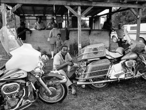 Black Motorcyclist of the Big Circle Motorcycle Association Sitting Between Harley Davidson Bikes by John Shearer