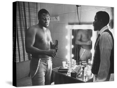Boxer Joe Frazier Dressing During Training for a Fight Against Muhammad Ali