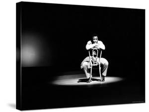 Boxer Joe Frazier Sitting on a Chair under a Spotlight by John Shearer