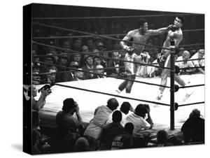 Joe Frazier Vs. Mohammed Ali at Madison Square Garden by John Shearer