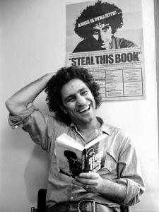 Yippie Leader Abbie Hoffman Holding Copy of His Book by John Shearer