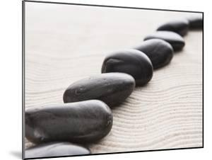Rocks on sand by John Smith