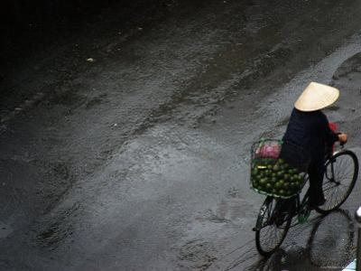 Person Cycling after Heavy Rain by John Sones