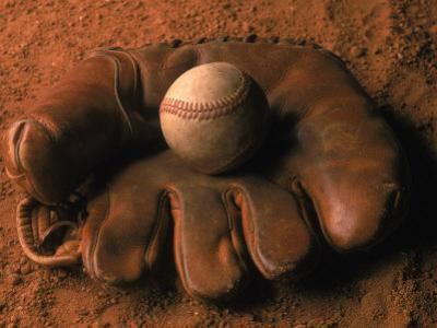 Baseball Glove with Ball on Dirt by John T^ Wong