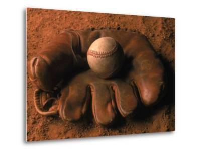 Baseball Glove with Ball on Dirt