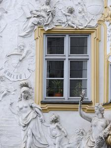 Germany, Bavaria, Munich, Ornate Stucco or Plasterwork Adorning the Front of a House in the City by John Warburton-lee