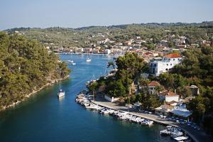 Greece, Paxos. Yachts and Pleasure Boats Moored in the Entrance to Gaios Harbour by John Warburton-lee