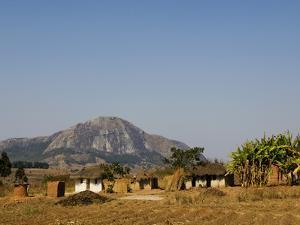 Malawi, Dedza, Grass-Roofed Houses in a Rural Village in the Dedza Region by John Warburton-lee