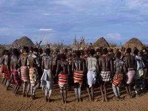 Men Hold Hands Forming a Circle Within Which the Women Dance in the Karo Village of Duss,Ethiopia by John Warburton-lee