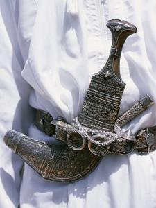 Omani Men Wear Traditional Long White Robes, Ceremonial Khanjar on Al Jabal Al Akhdar by John Warburton-lee