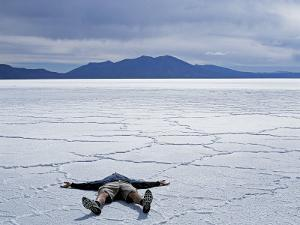 Tourist on Salt Crust of Salar De Uyuni, Emphasising Scale of Largest Salt Flat in World, Bolivia by John Warburton-lee