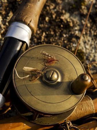 Traditional Brass Fishing Reel Fitted to a Split-Cane Fly Rod with Trout Fishing Flies, UK