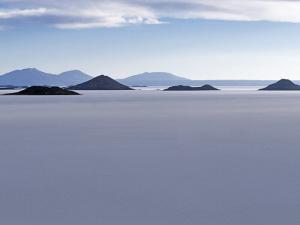 View across Salar De Uyuni, the Largest Salt Flat in World, Towards the Distant Andean Peaks by John Warburton-lee
