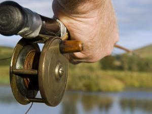 Wales, Conwy, Trout Fishing at a Hill Lake in North Wales, UK by John Warburton-lee