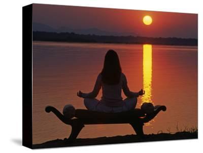 Yoga on a Saddle Bench Watching the Sun Go Down across the Zambesi River, Zambia