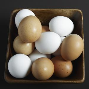White and Brown Eggs in Basket by John Wilkes