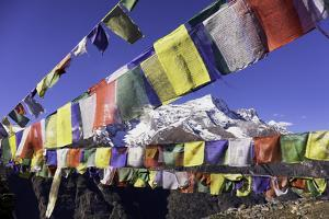Buddhist Prayer Flags with Mount Kongde Ri Behind Taken Just Above the Town of Namche Bazaar by John Woodworth