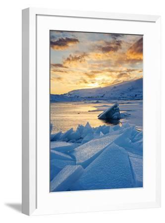 Jokulsarlon glacier lagoon, Iceland, Europe. Blocks of ice in the frozen lagoon on a winter sunset.-Marco Bottigelli-Framed Photographic Print