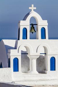 Oia, Greece. Greek Orthodox Church steeple by the Aegean Sea by Jolly Sienda