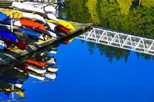 Port Ludlow Marina, Washington State. Colorful kayaks and a white bridge by Jolly Sienda
