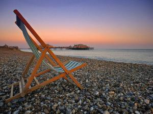 Beach at Brighton, East Sussex, England by Jon Arnold