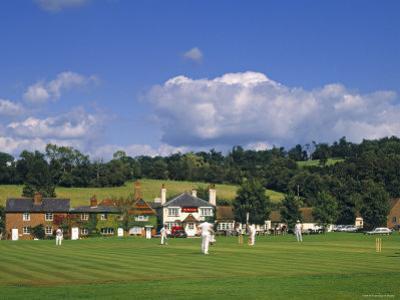 Cricket on Village Green, Surrey, England