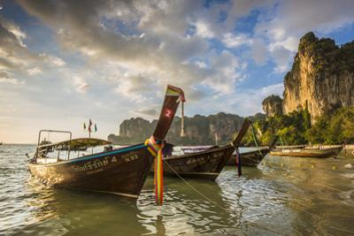 Longtail boats on West Railay beach, Railay Peninsula, Krabi Province, Thailand by Jon Arnold