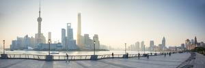 Pudong Skyline across the Huangpu River, the Bund, Shanghai, China by Jon Arnold