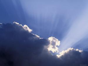Sun Rays Through Clouds by Jon Arnold