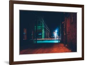 Dark Alley and Light Trails in Hanover, Pennsylvania at Night. by Jon Bilous