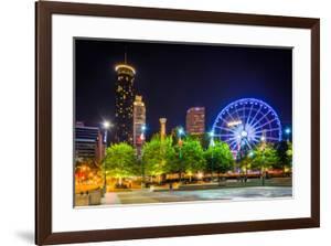 Ferris Wheel and Buildings Seen from Olympic Centennial Park at Night in Atlanta, Georgia. by Jon Bilous