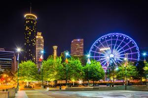 Ferris Wheel and Buildings Seen from Olympic Centennial Park at Night in Atlanta, Georgia. by Jon Bilous