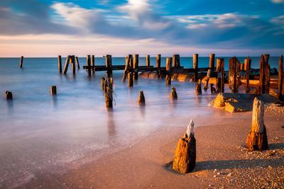 Long Exposure at Sunset of Pier Pilings in the Delaware Bay at Sunset Beach, Cape May, New Jersey.
