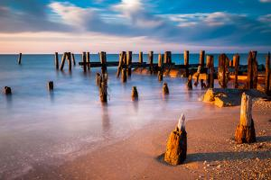 Long Exposure at Sunset of Pier Pilings in the Delaware Bay at Sunset Beach, Cape May, New Jersey. by Jon Bilous