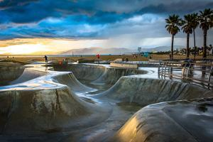 The Venice Skate Park at Sunset, in Venice Beach, Los Angeles, California. by Jon Bilous