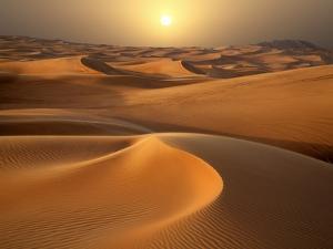Intense Sun over sand dunes around Dubai by Jon Bower