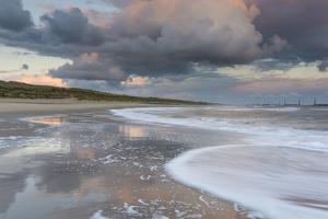 A beautiful cloudscape and wild sea at Waxham, Norfolk, England, United Kingdom, Europe by Jon Gibbs