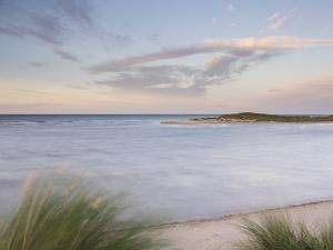 A high tide on a windy evening at Holkham Bay, Norfolk, England, United Kingdom, Europe by Jon Gibbs