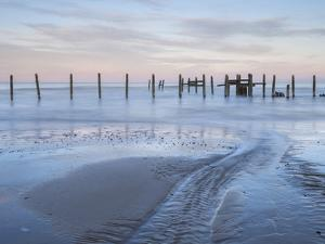 A view of the sea defences on the shoreline at Happisburgh, Norfolk, England, United Kingdom, Europ by Jon Gibbs
