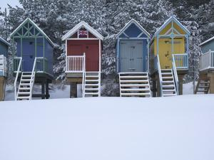 Beach Huts in the Snow at Wells Next the Sea, Norfolk, England by Jon Gibbs