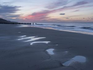 Beautiful sunset colours over the beach at low tide at Mundesley, Norfolk, England, United Kingdom, by Jon Gibbs