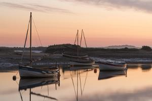 Boats in the channel on a beautiful morning at Burnham Overy Staithe, Norfolk, England, United King by Jon Gibbs