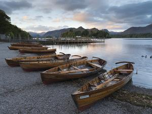 Pleasure boats on the shore at Derwentwater, Lake District National Park, Cumbria, England, United  by Jon Gibbs