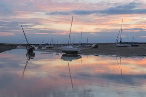 Sunset over the tidal channel at Brancaster Staithe, Norfolk, England, United Kingdom, Europe by Jon Gibbs
