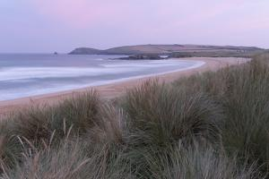 The dunes and beach at Constantine Bay, Cornwall, England, United Kingdom, Europe by Jon Gibbs
