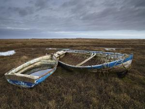 Two Old Boats on the Saltmarshes at Burnham Deepdale, Norfolk, England by Jon Gibbs