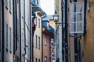 Historic and colorful buildings in Hell's Alley, Gamla Stan, Stockholm, Sweden, Scandinavia, Europe by Jon Reaves