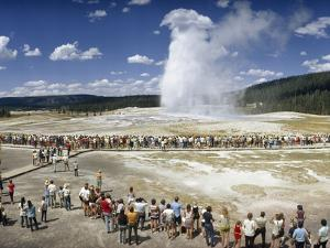 Crowds of Tourists Flock around the Erupting Old Faithful Geyser by Jonathan Blair